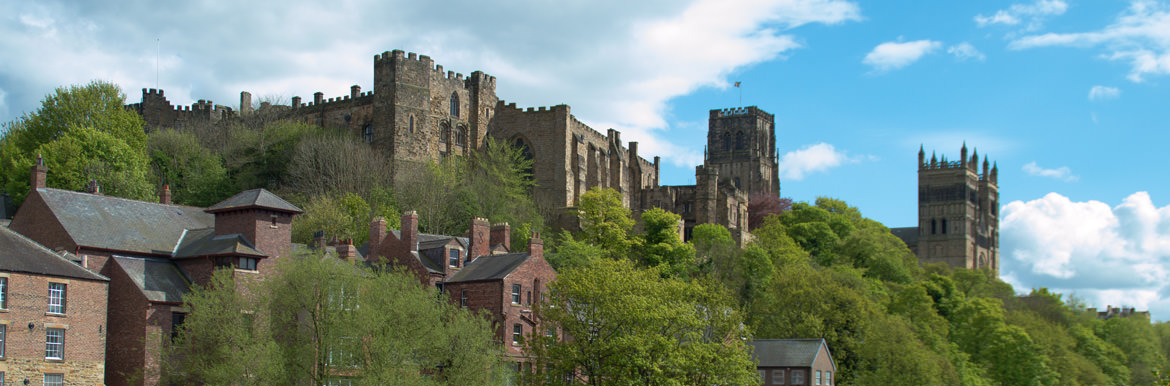 Image of Durham Cathedral and Castle on a lovely summers day surrounded by green trees. Taken from Durham Gates.